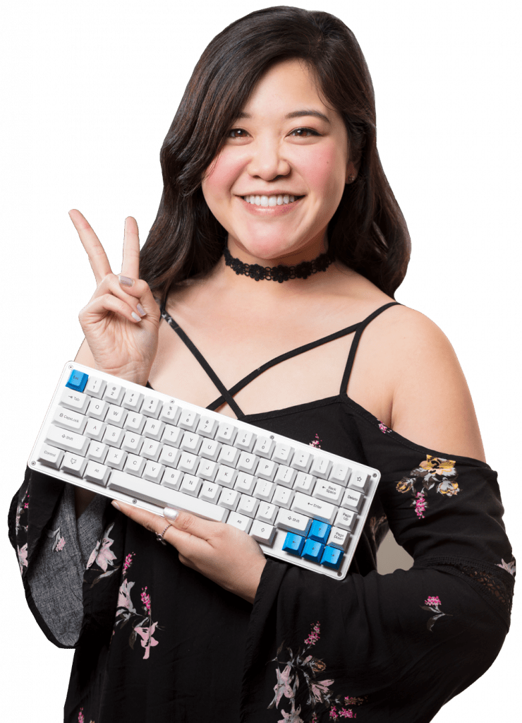 A WhiteFox Mechanical Keyboard held by a Keyboard Spokesperson